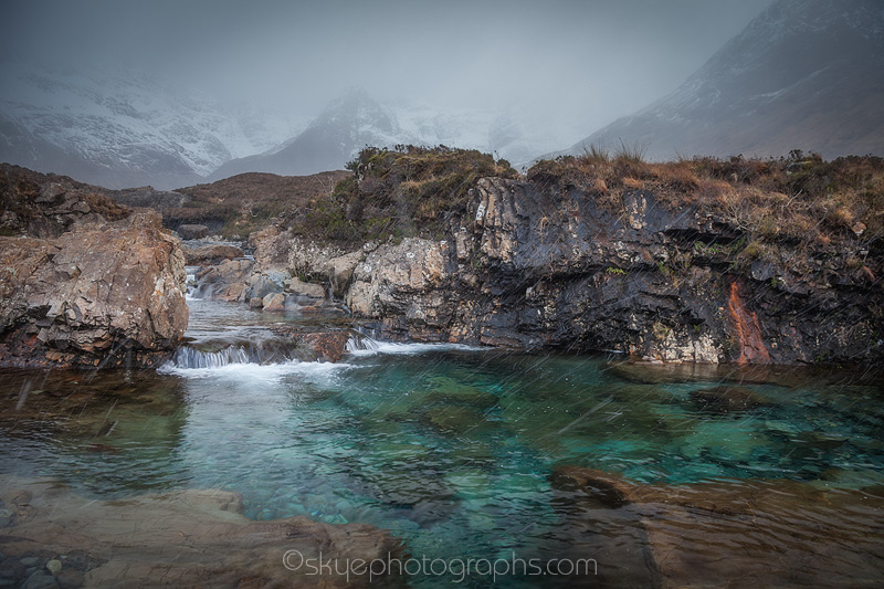 Fairy Pools Turquise pool in the Snow