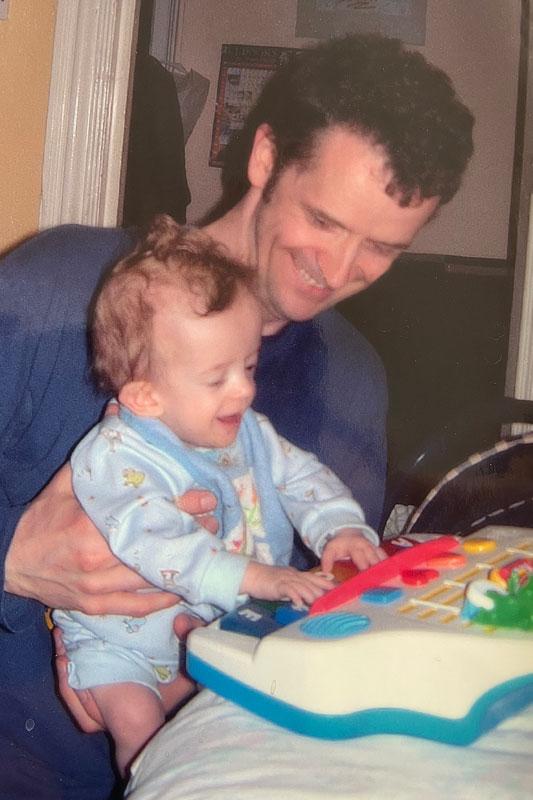 Caleb with Dad at the piano